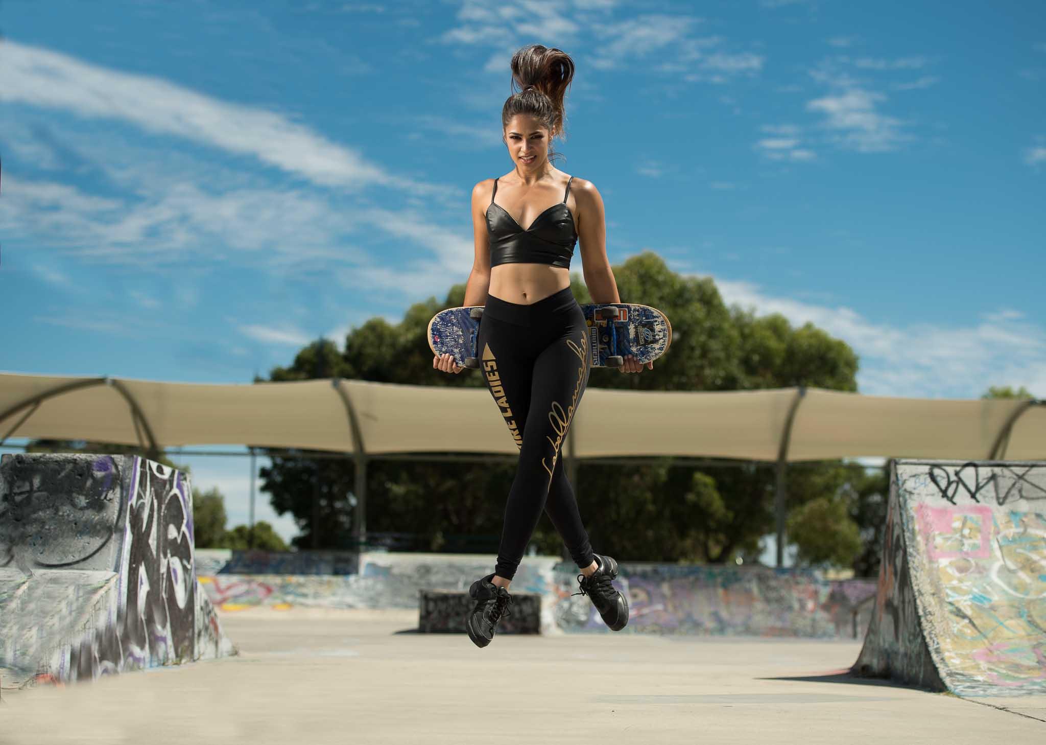 Karina jumping in skateboard park