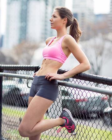 Kate B wearing pink Nike training top during training session