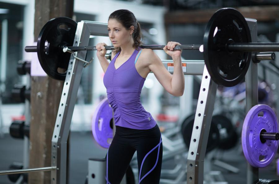 Kate Melbourne's female fitness model squatting