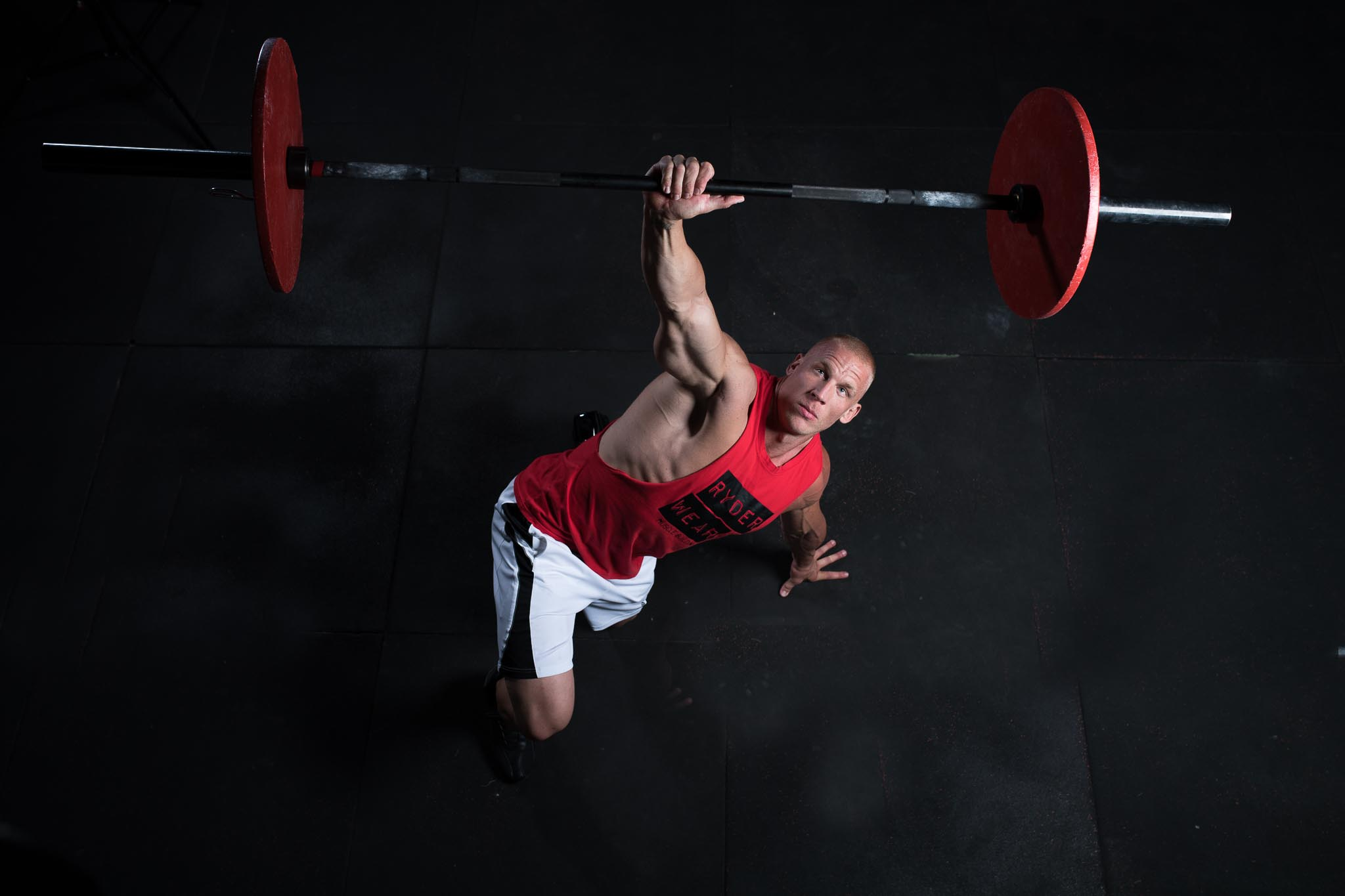 Keagan performing a Russian get up with Barbell