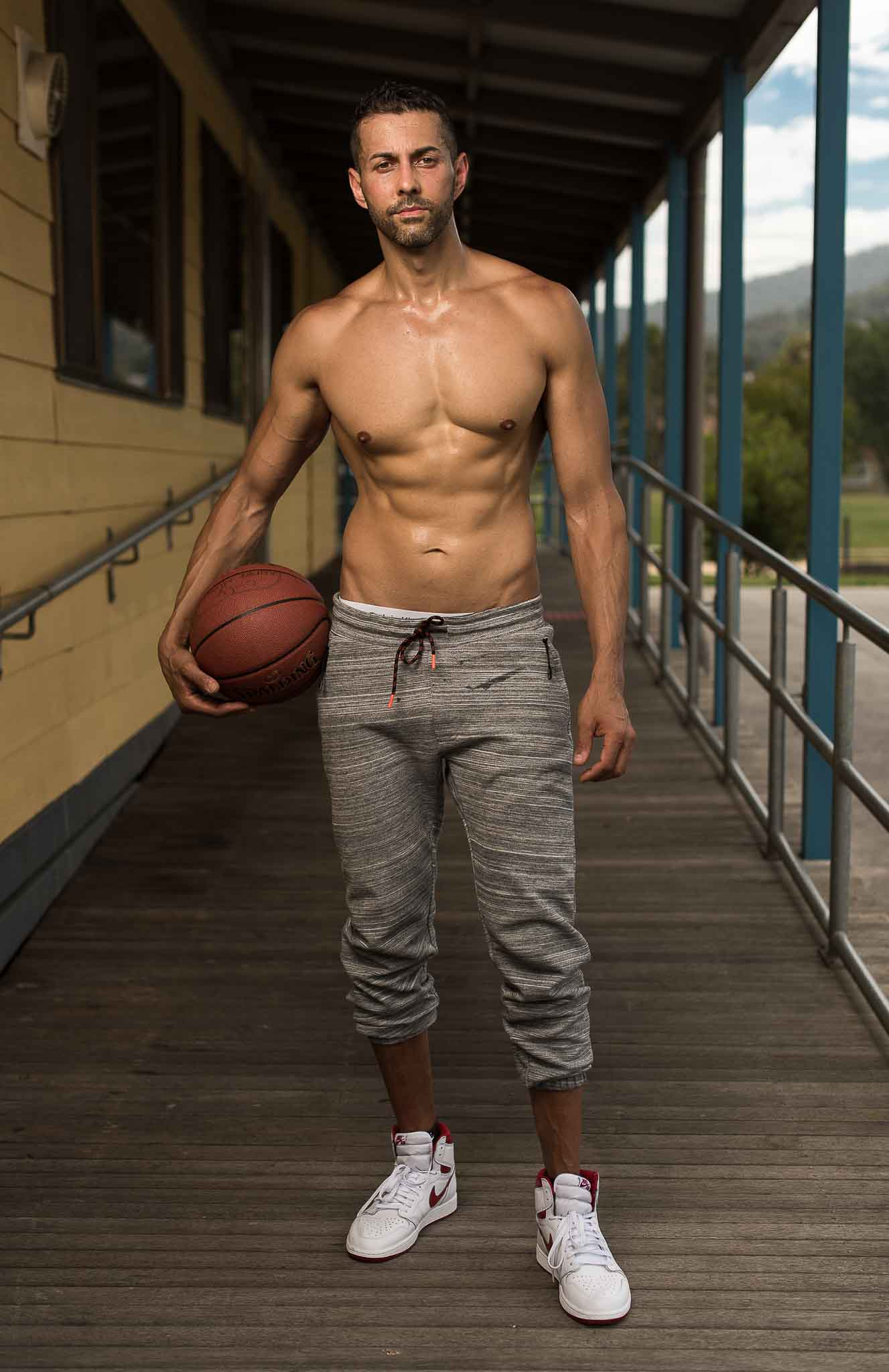 Keith Melbourne's mature male fitness model holding basketball
