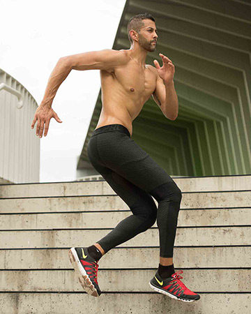 Keith Melbourne male fitness model running sideways up a flight of stairs