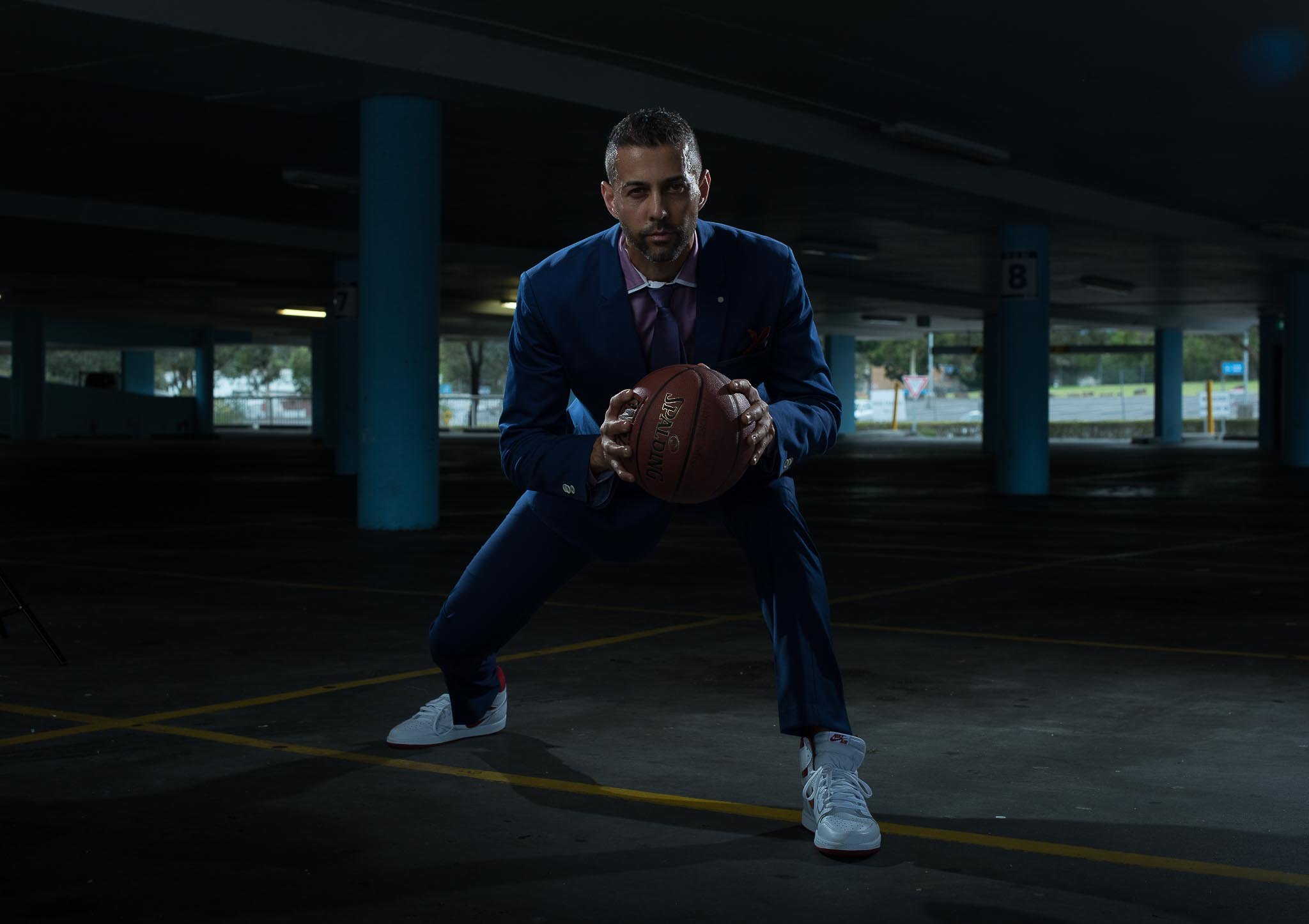 Keith wearing suit during sports couture photo shoot