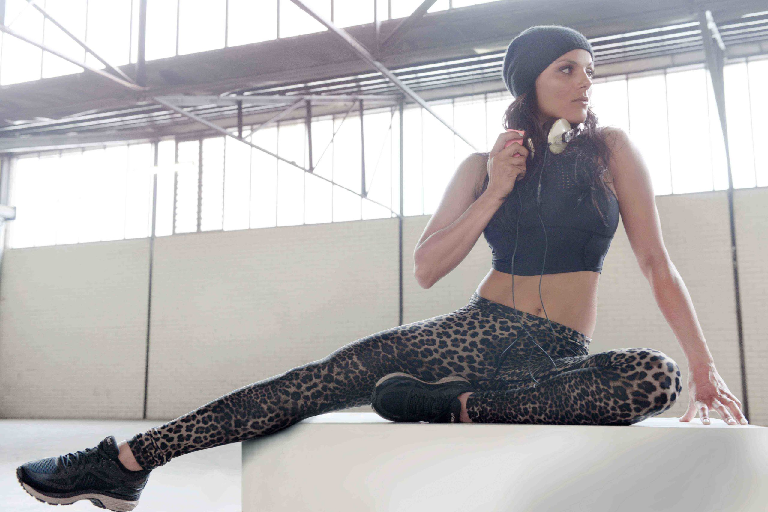 Kerri Sydney's leading fitness model being photographed in old warehouse