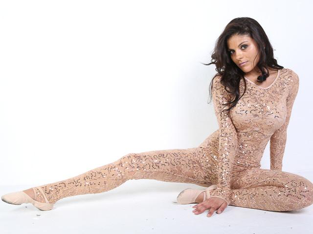Kerri in photo studio wearing glittery one piece outfit