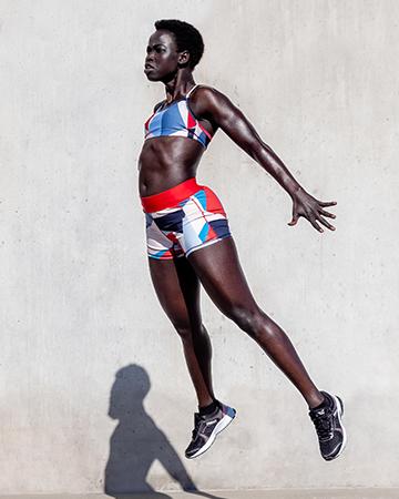 Kim Melbourne black Sudanese model jumping explosively