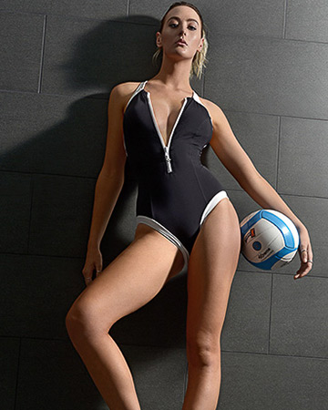 Lauren Perth fitness model holding netball whilst wearing black one piece swimsuit