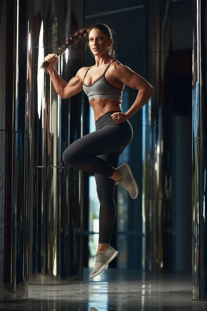 Layla jumping amongst glass structure