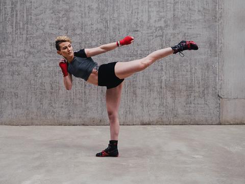 Lisa performing a side kick