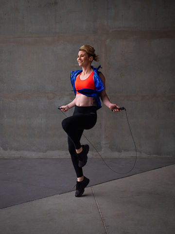Lisa skipping in concreted industrial area