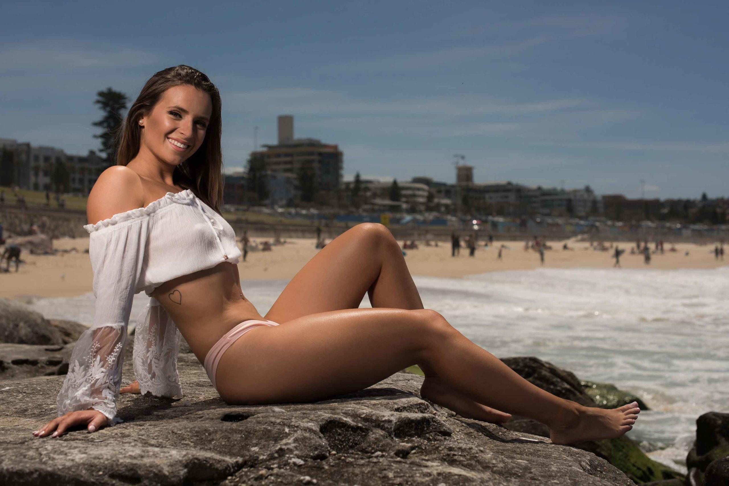 Maya seated at Bondi Beach