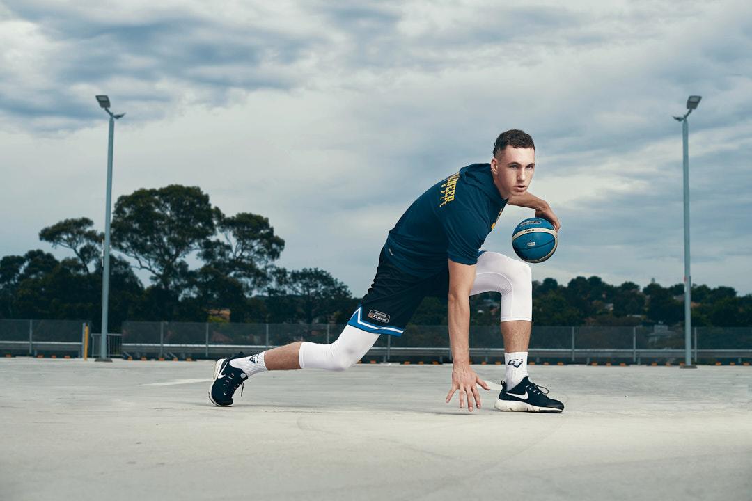 Mayty sidestepping, dribbling basketball