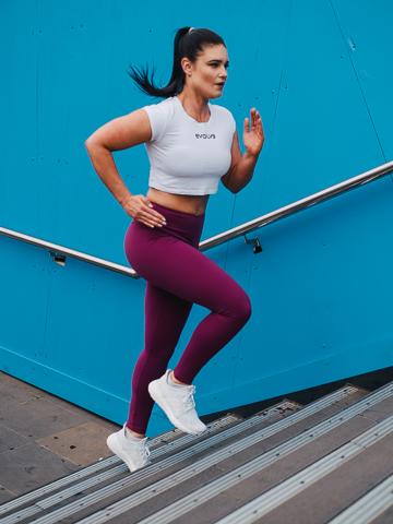 Megan running upstairs and fitness garments