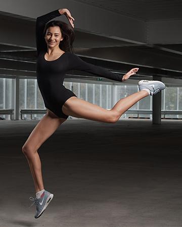 Michaela performing contemporary dance move in Melbourne car park