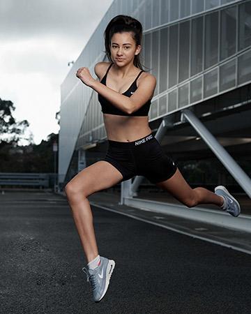 Michaela wearing Nike pro jumping