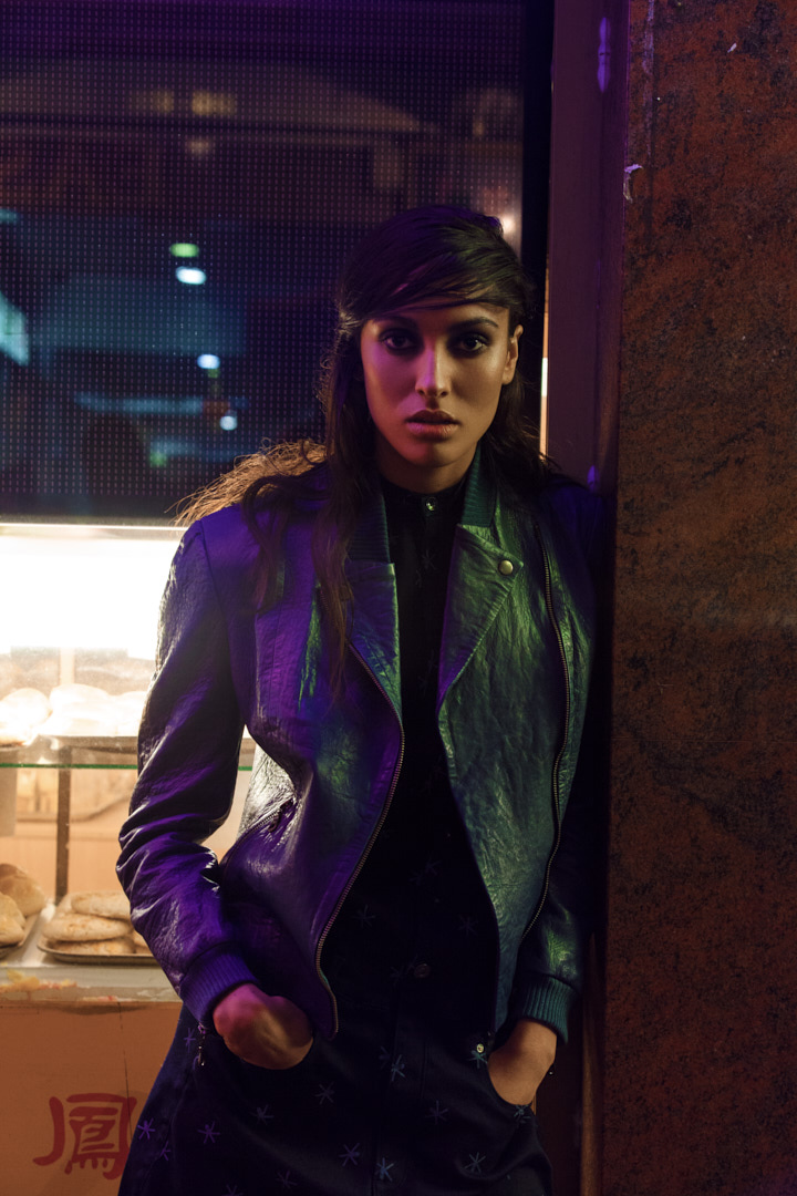 Montana Melbourne's elite female fitness model during fashion shoot wearing leather jacket during night shoot