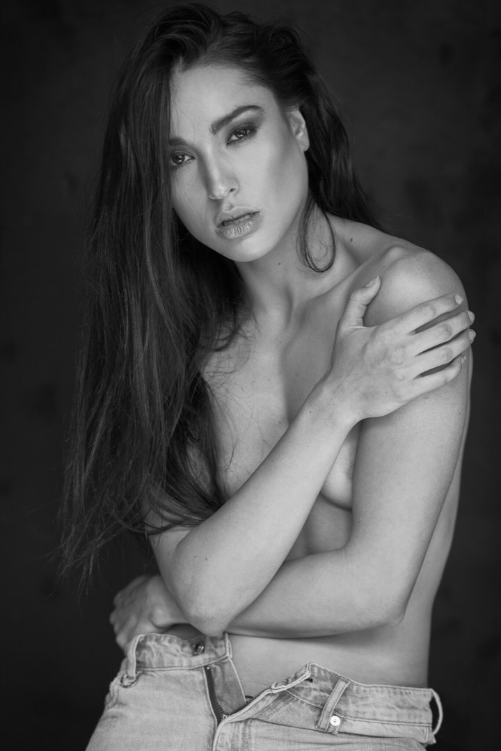 Montana during sassy black-and-white photo shoot in studio
