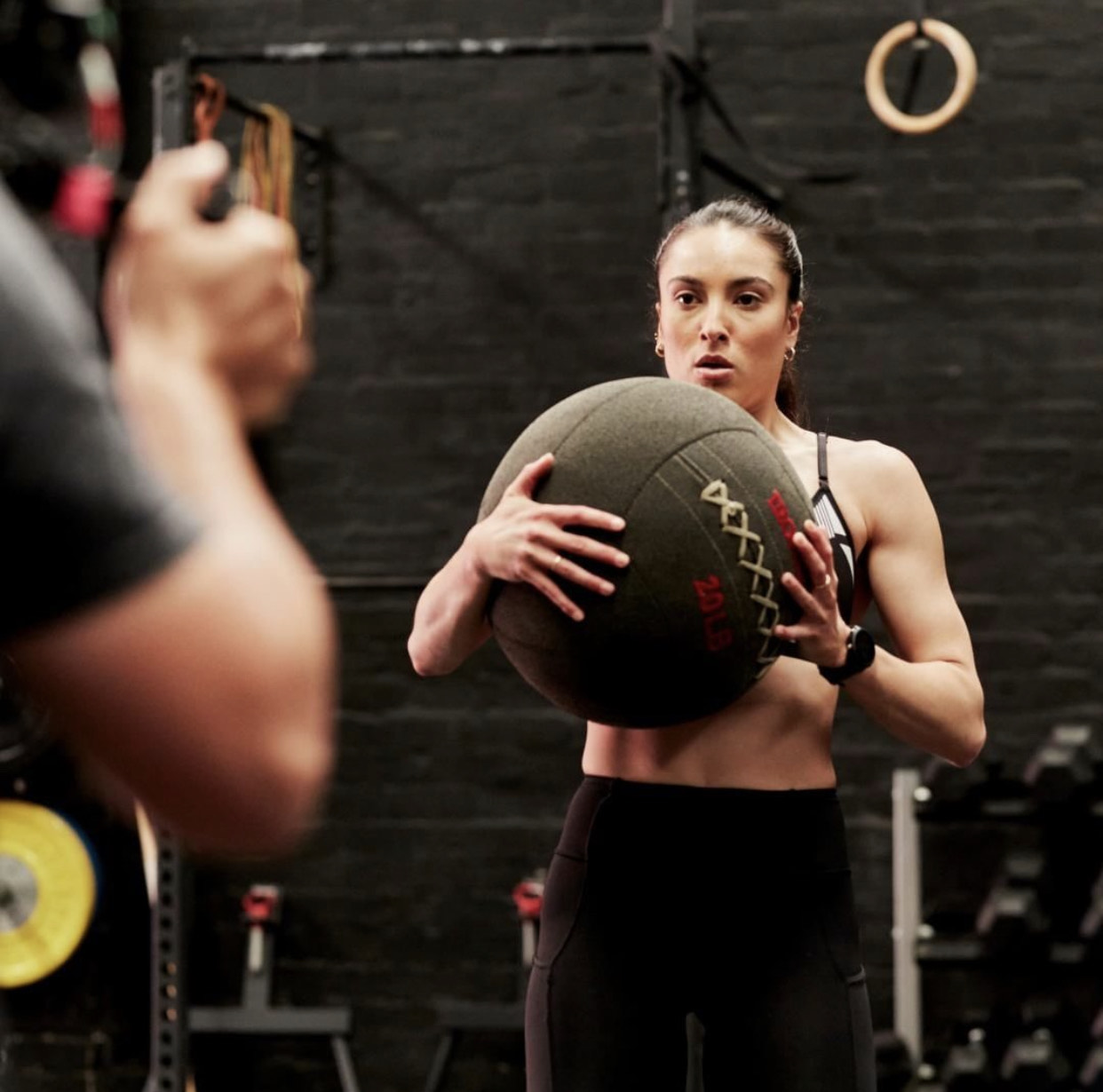 Montana holding a medicine ball during her PMRG fitness campaign