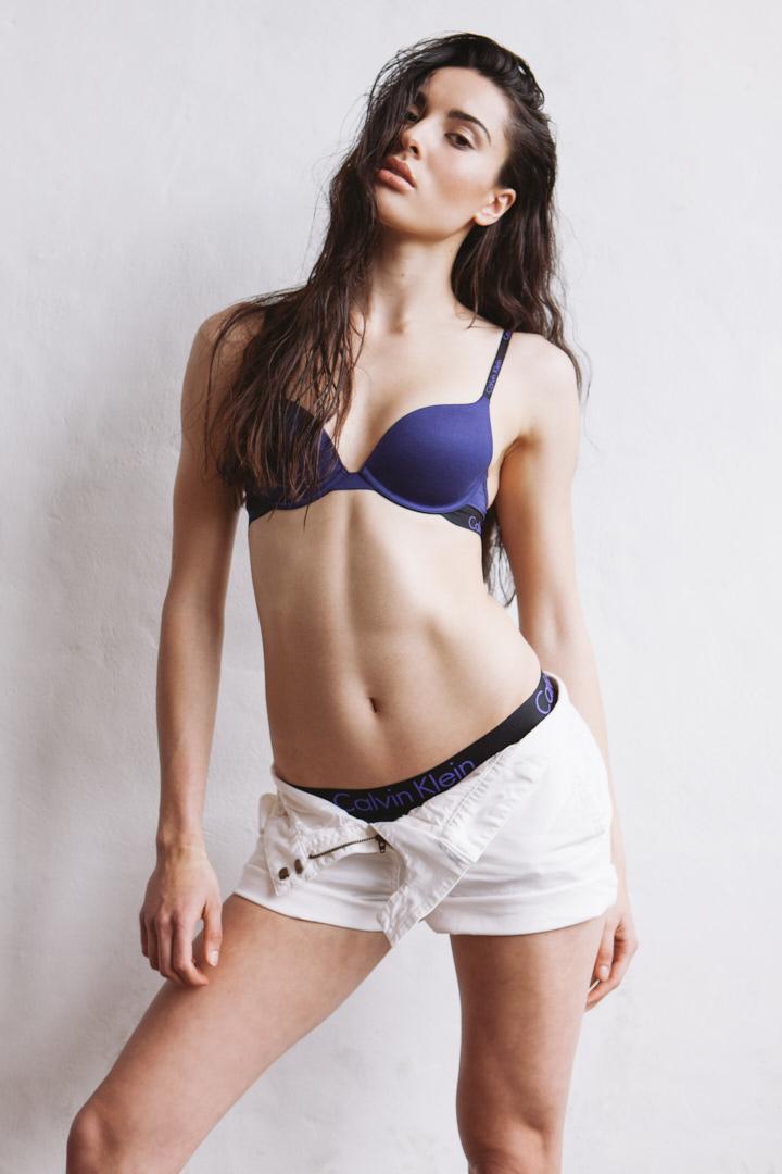 Montana in studio wearing Calvin Klein shorts and matching bra