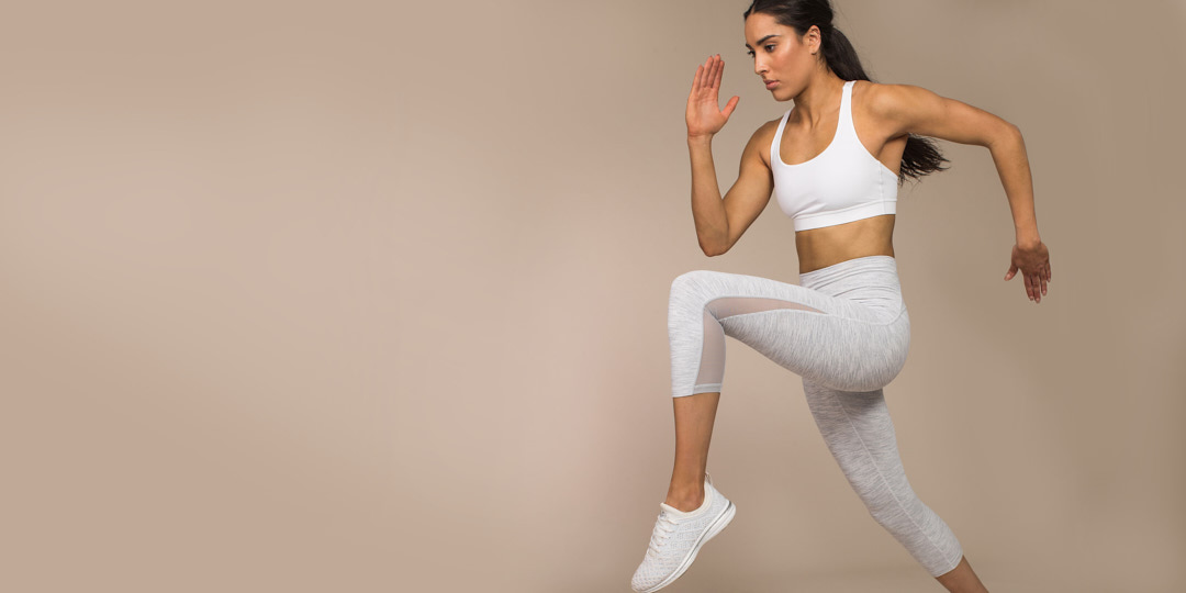 Montana jumping in her sports leggings and crop top during her Lululemon fitness campaign