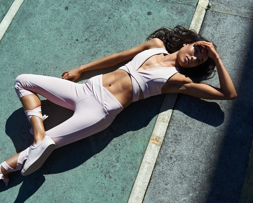 Montana laying down on a tennis court