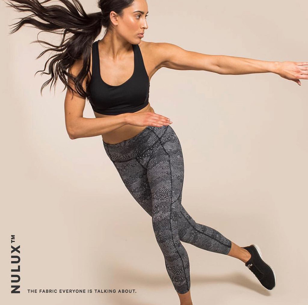 Montana side jumping wearing her branded nulux garments during a fitness campaign
