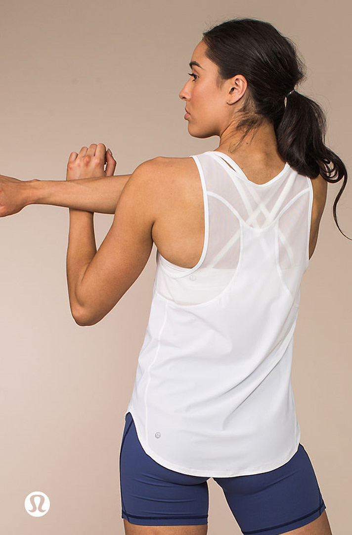 Montana stretching her right tricep during a Lululemon shoot, looking to her left side