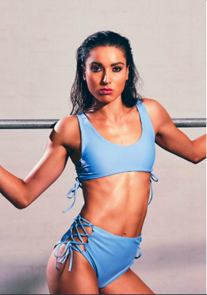 Montana wearing a cropped blue top and blue shorts during her fitness photo shoot