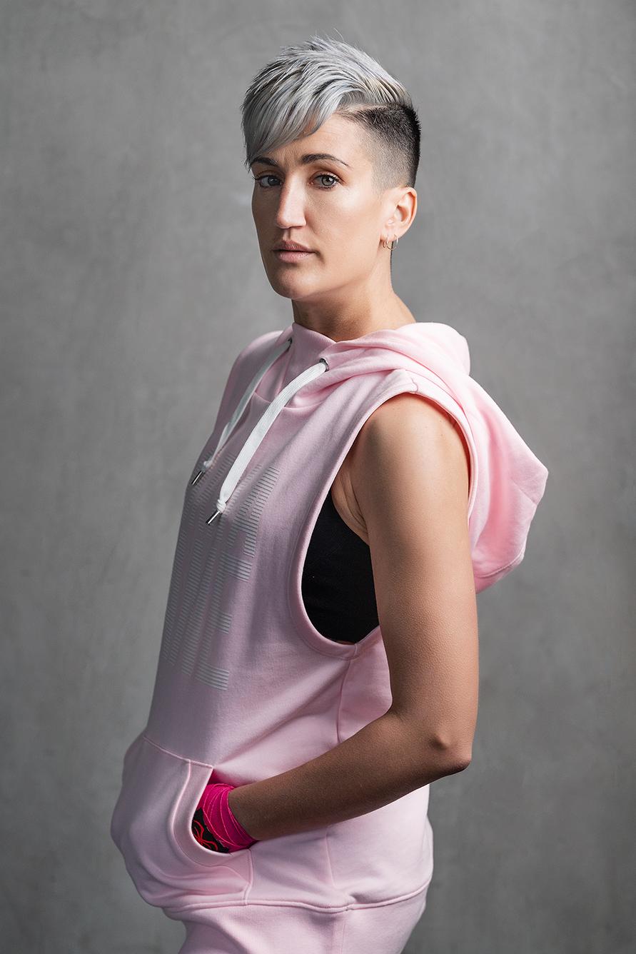 Natalie E wearing a pink sports Hoody