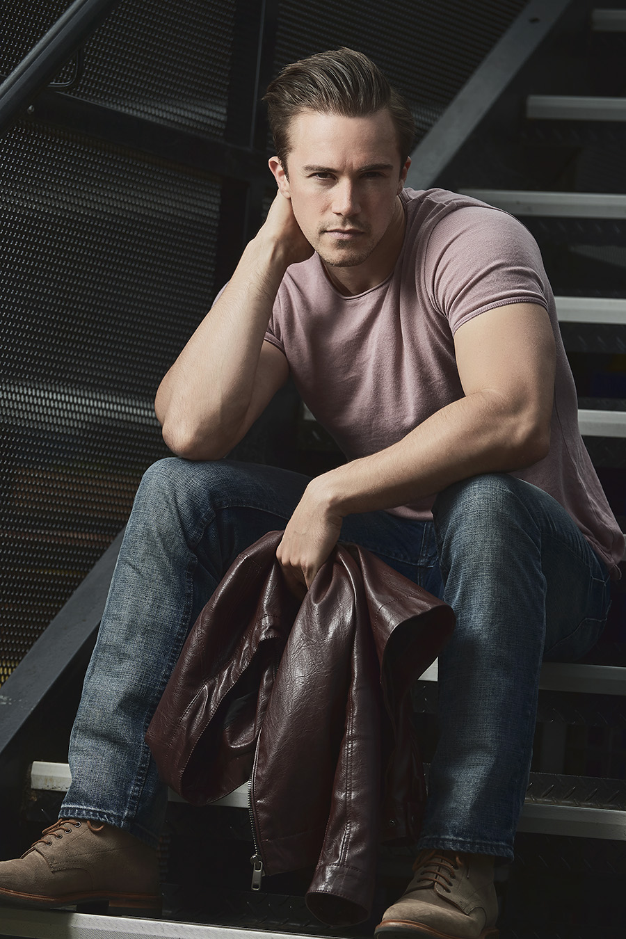 Neal seated on stairwell