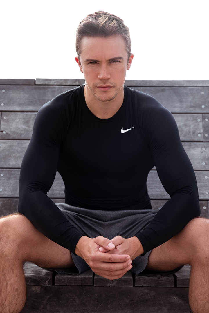 Neal seated wearing grey Nike shorts and longsleeve compression gear