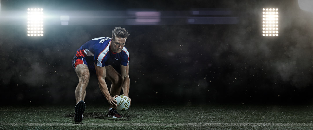 Neil playing rugby during bison campaign