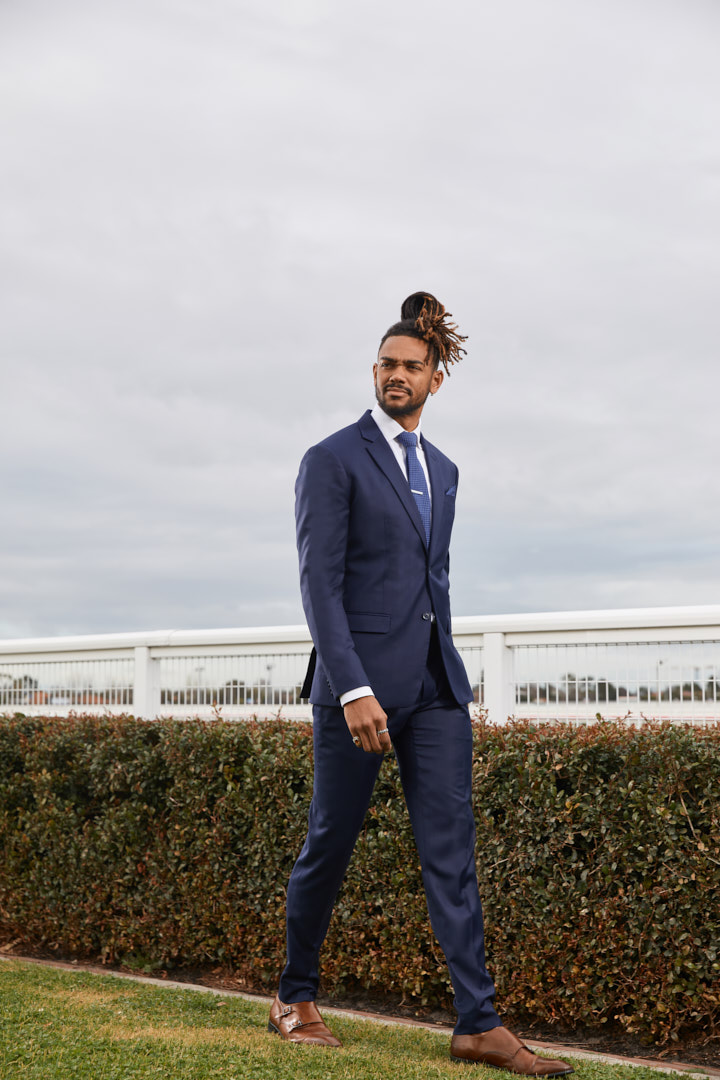 Nic walking on a horse racing track for Melbourne Cup horseracing campaign