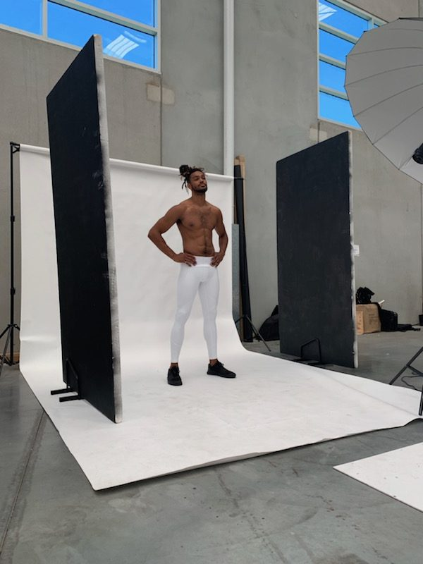 Nick Melbourne's male fitness talent standing in cyclorama during studio shoot