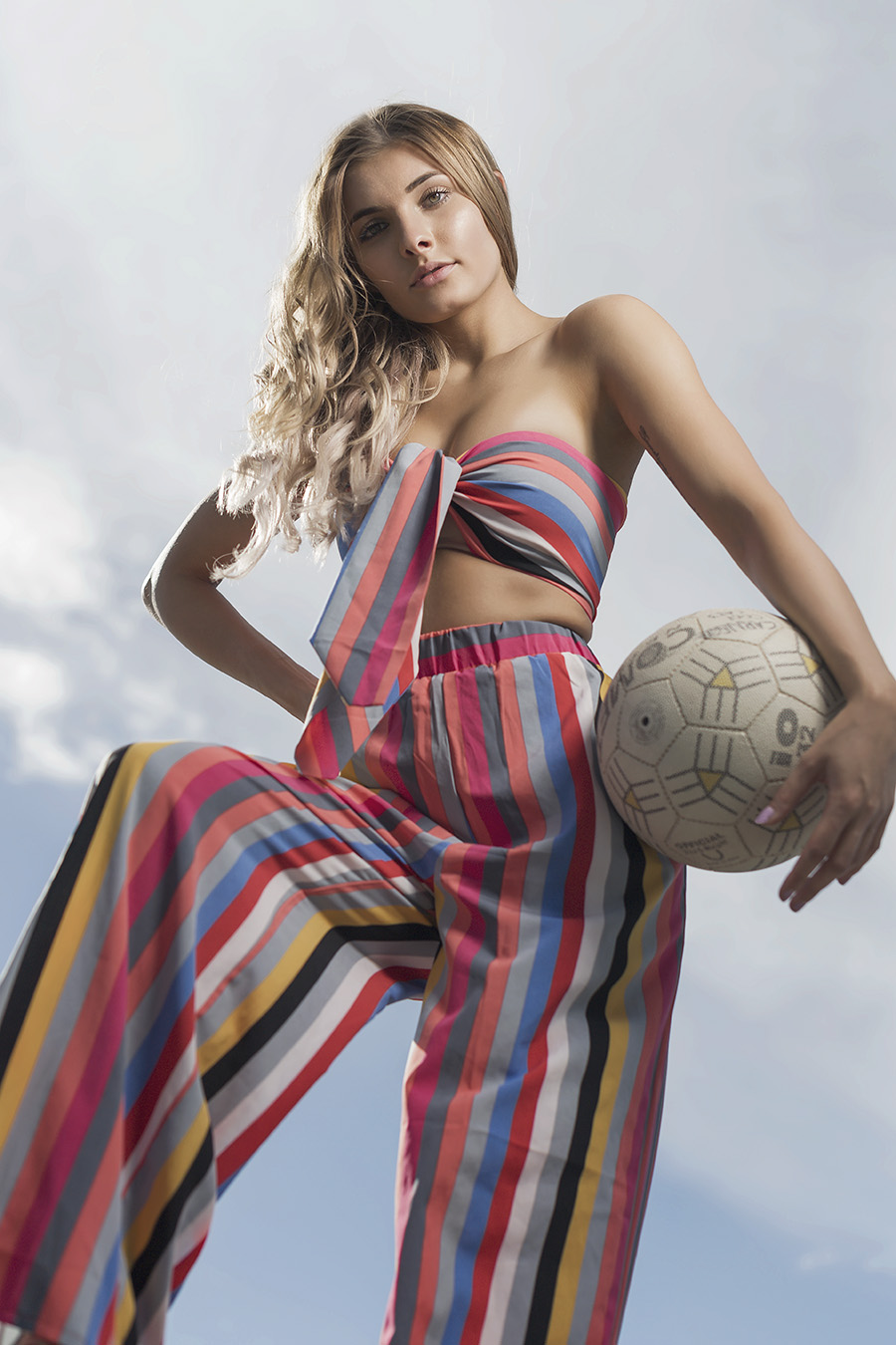 Nikita during her fitness shoot wearing fashion clothing holding a netball