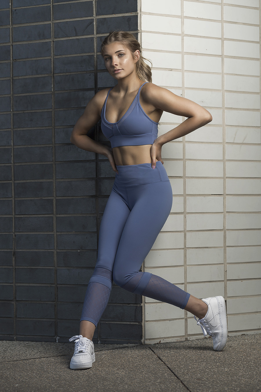 Nikita performing a traditional fashion pose whilst wearing her fitness garments