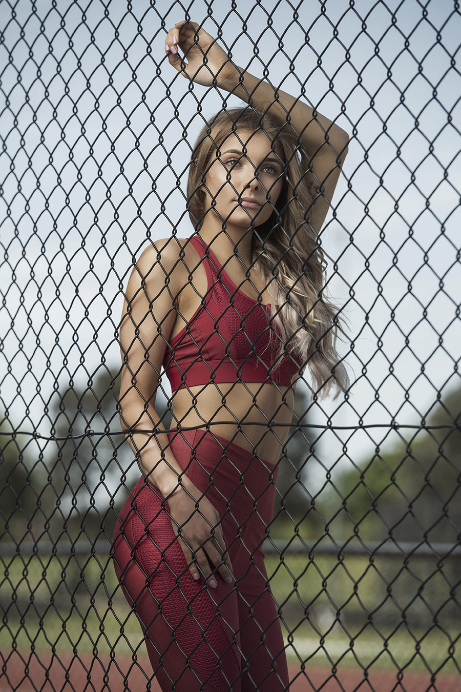 Nikita standing behind a wired fence