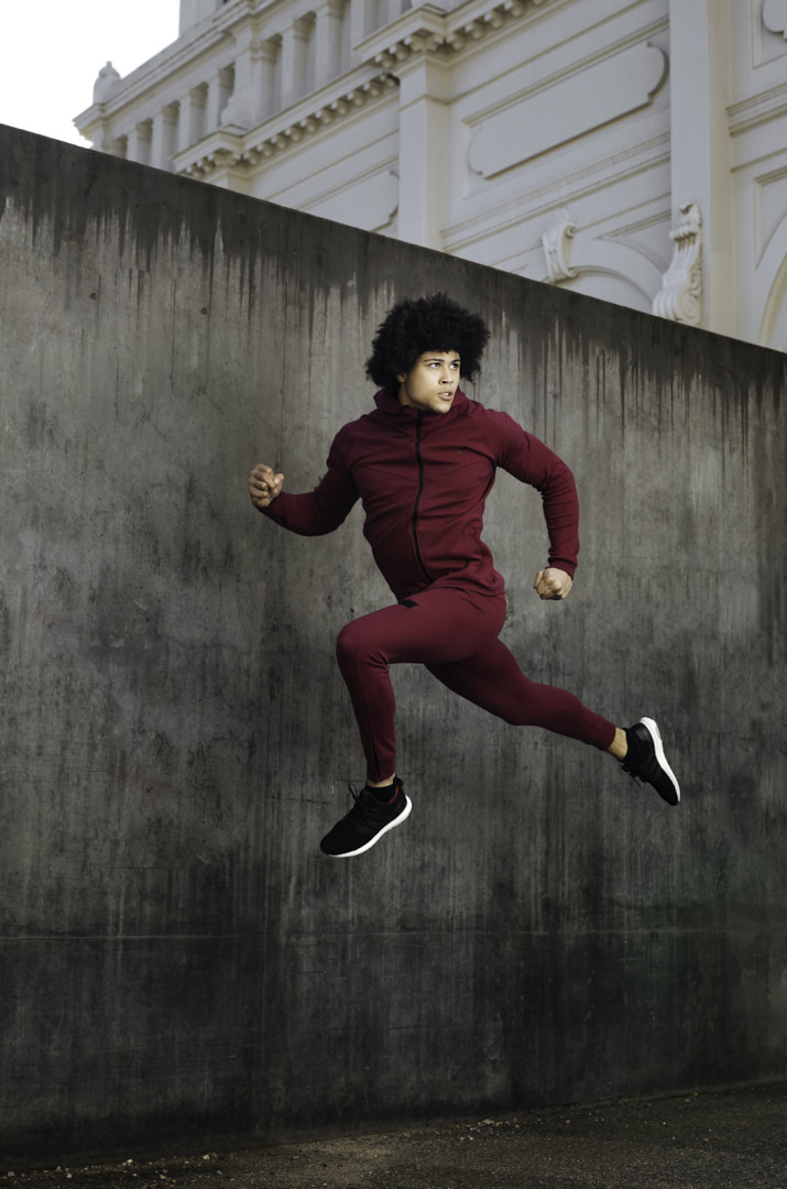 Ossie a Melbourne elite fitness model leaping high as he shoots for a leading brand