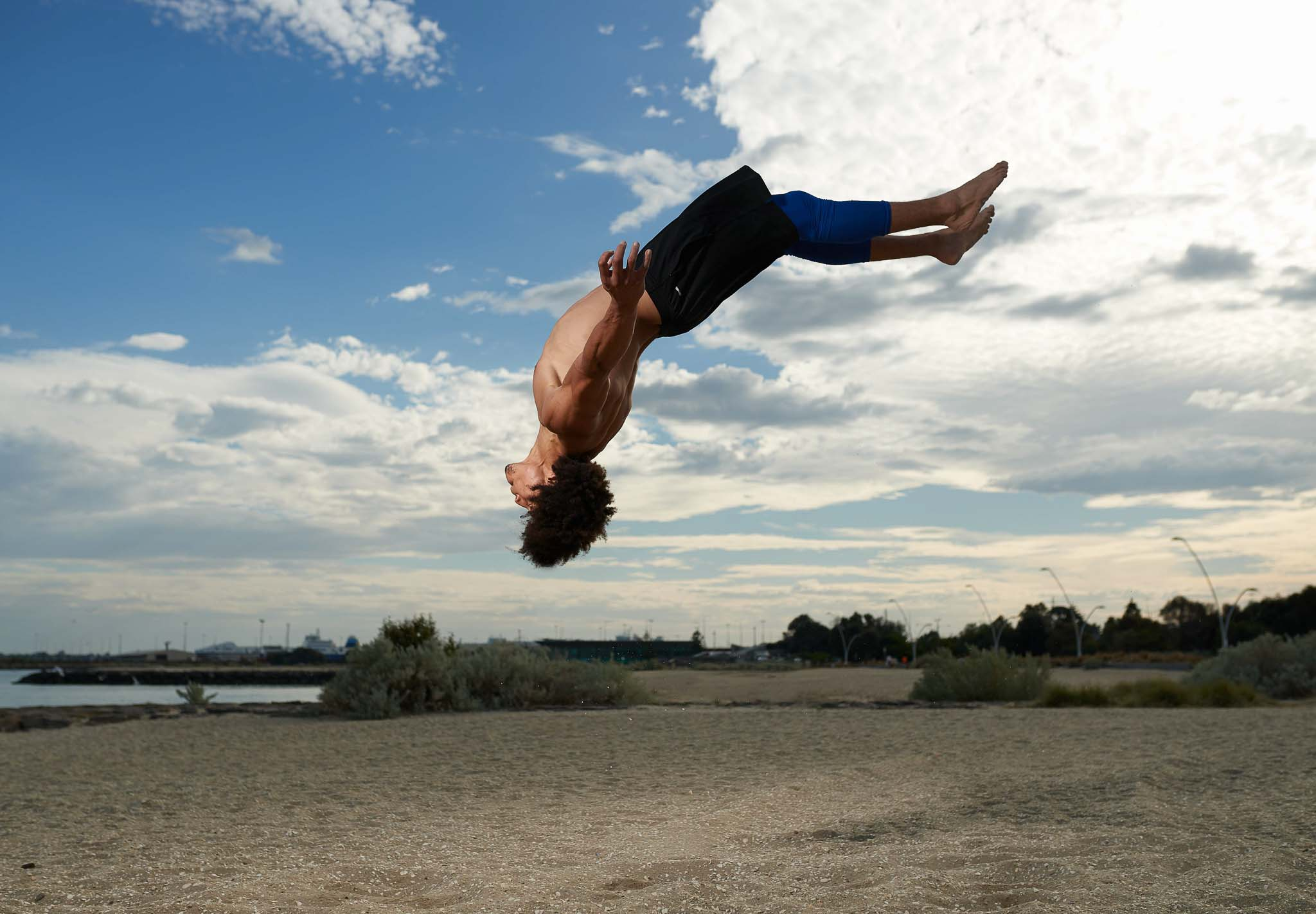 Ossie doing a back-flip at the beach