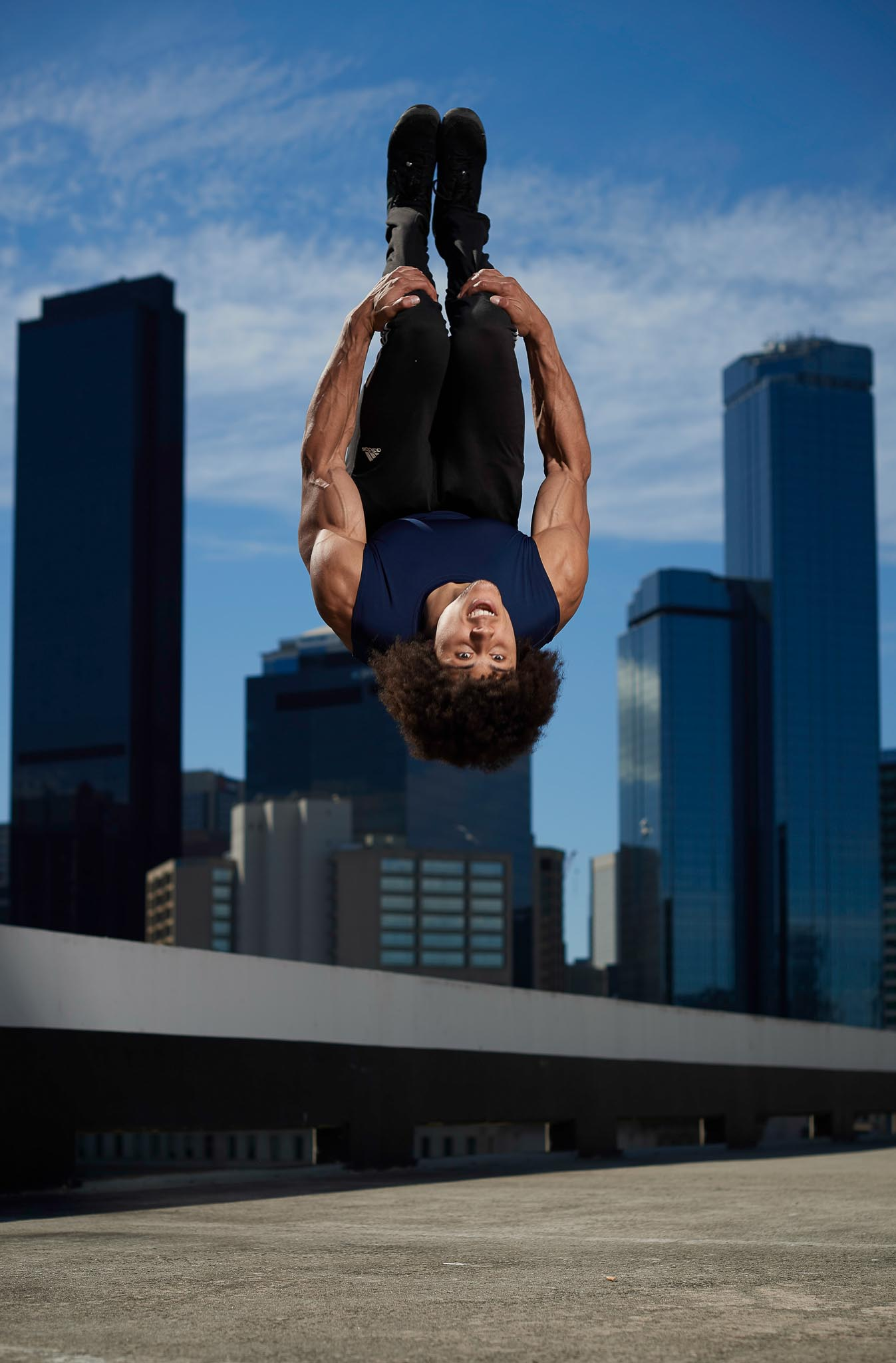Ossie doing a backflip on downtown Melbourne car park rooftop