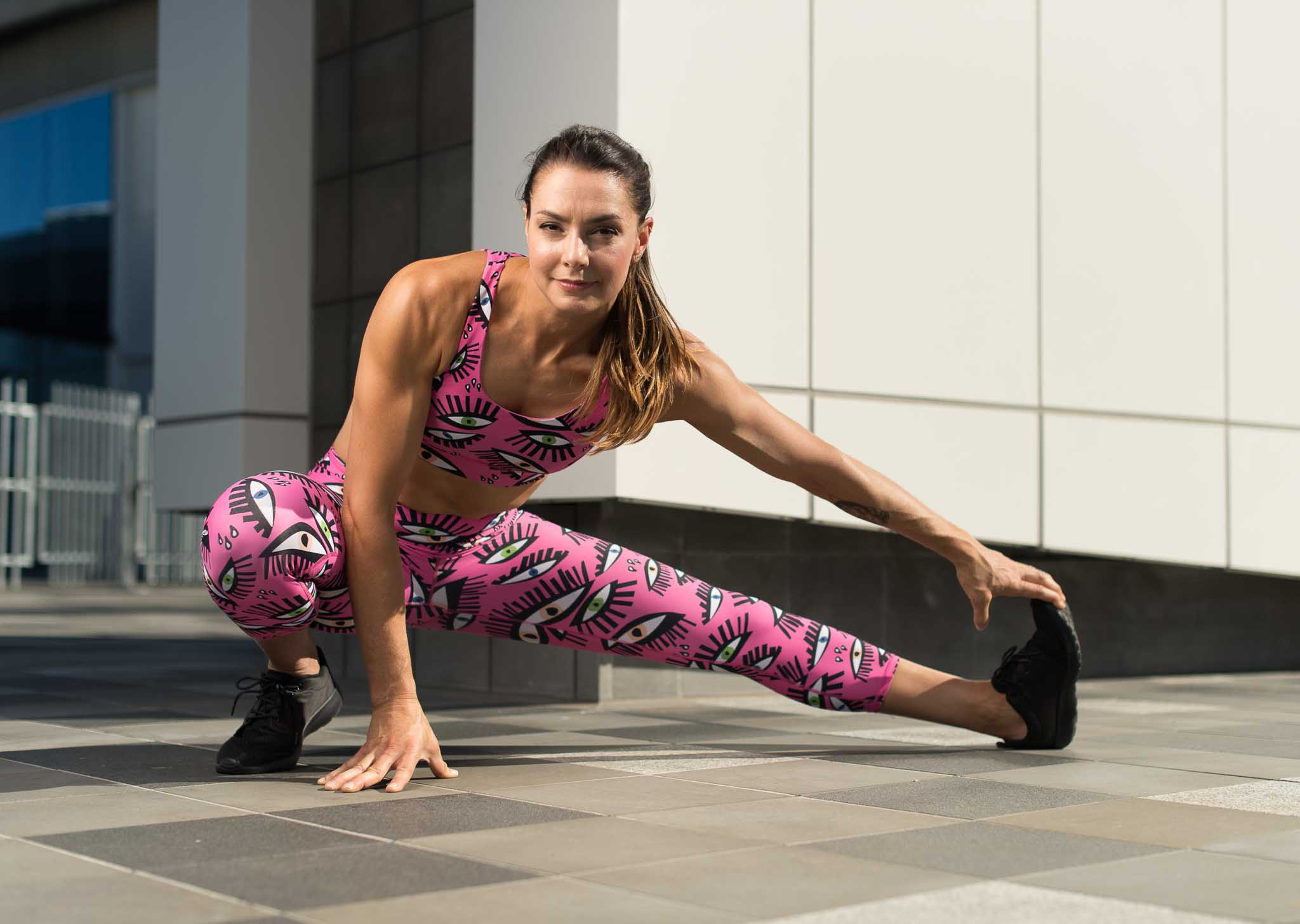 Paula stretching in funky pink fitness garments