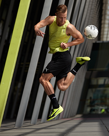 Sam Melbourne male fitness model doing soccer tricks