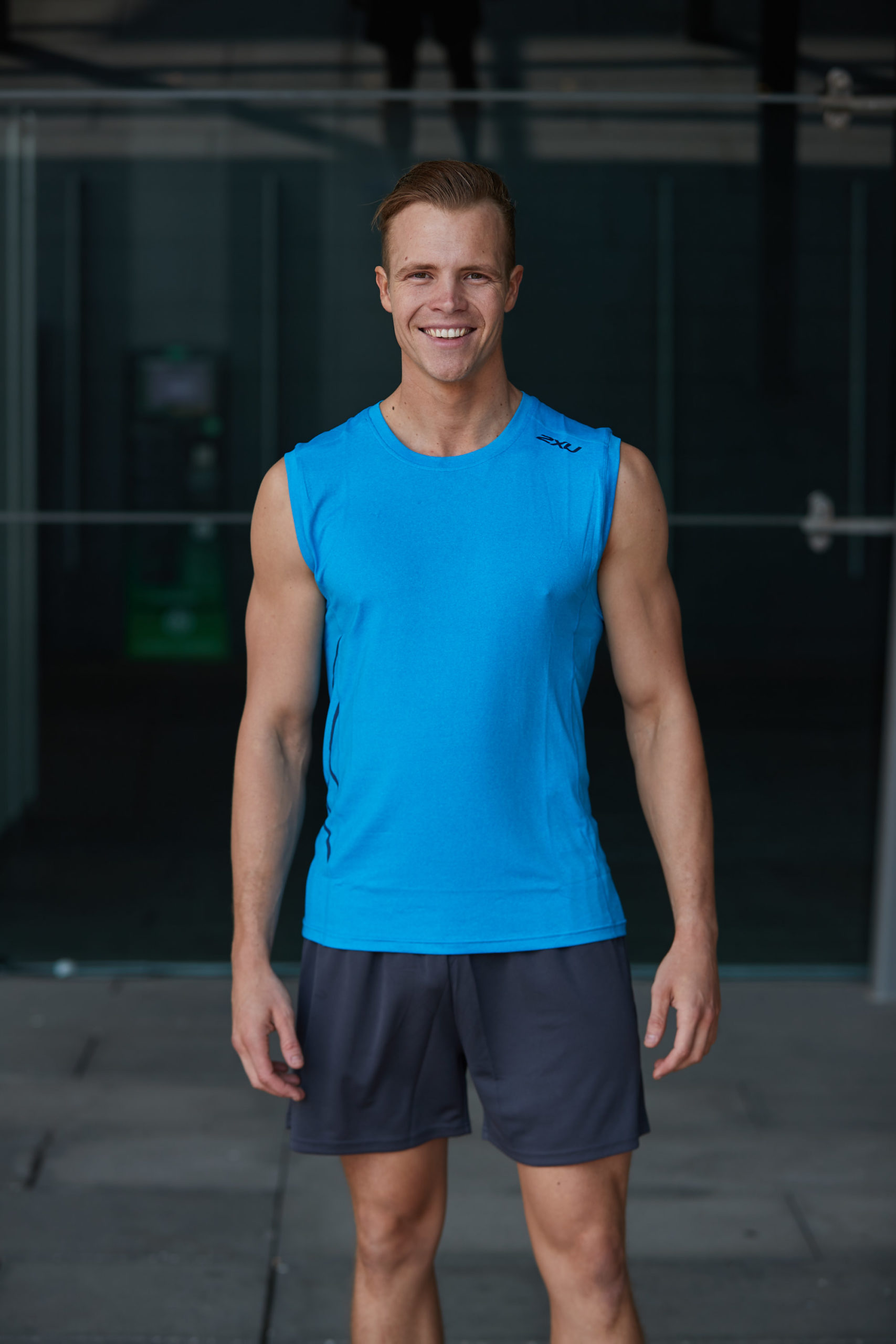 Sam smiling during his Melbourne fitness photo shoot