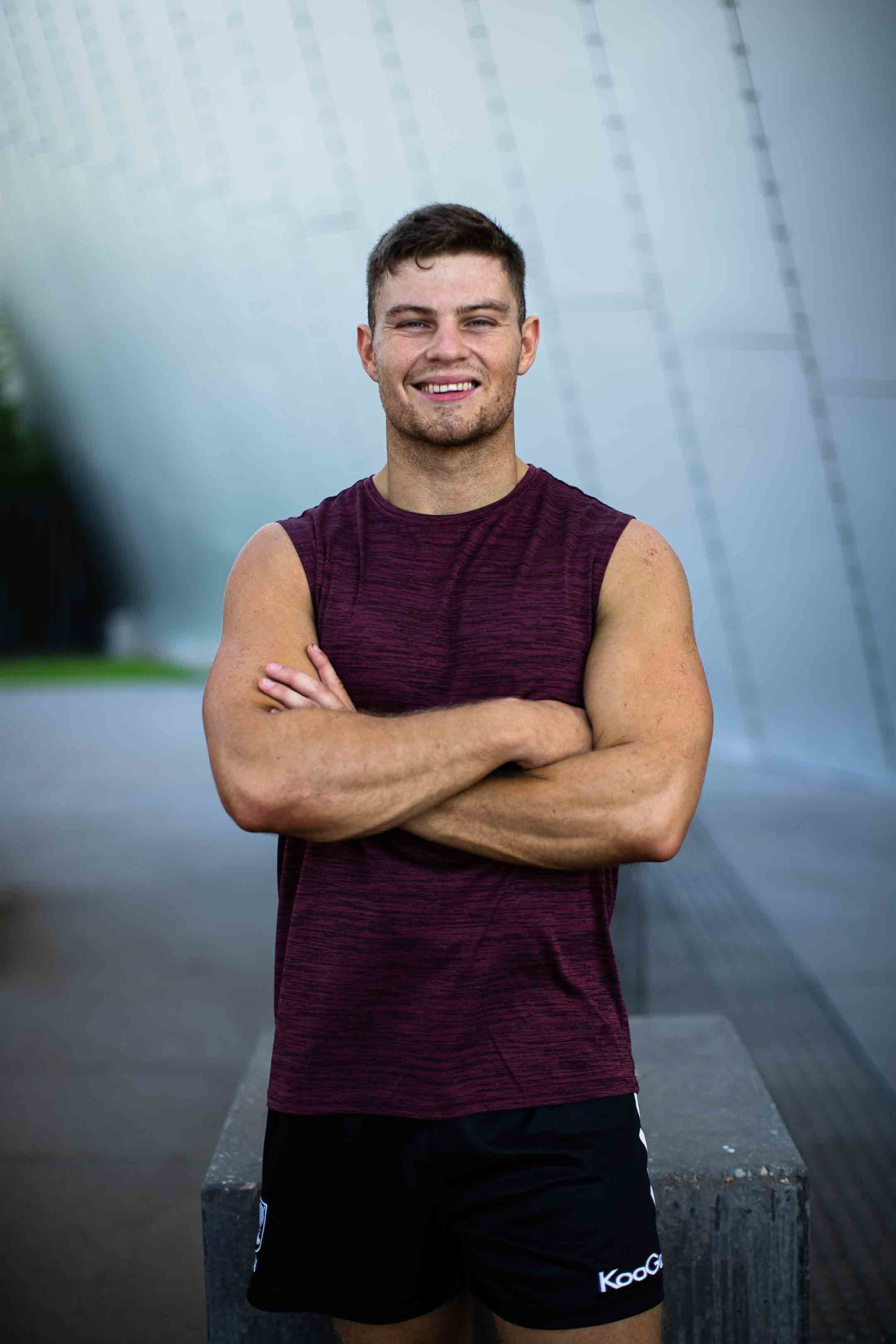 Sean crossing his arms during a fitness shoot at the Melbourne Museum
