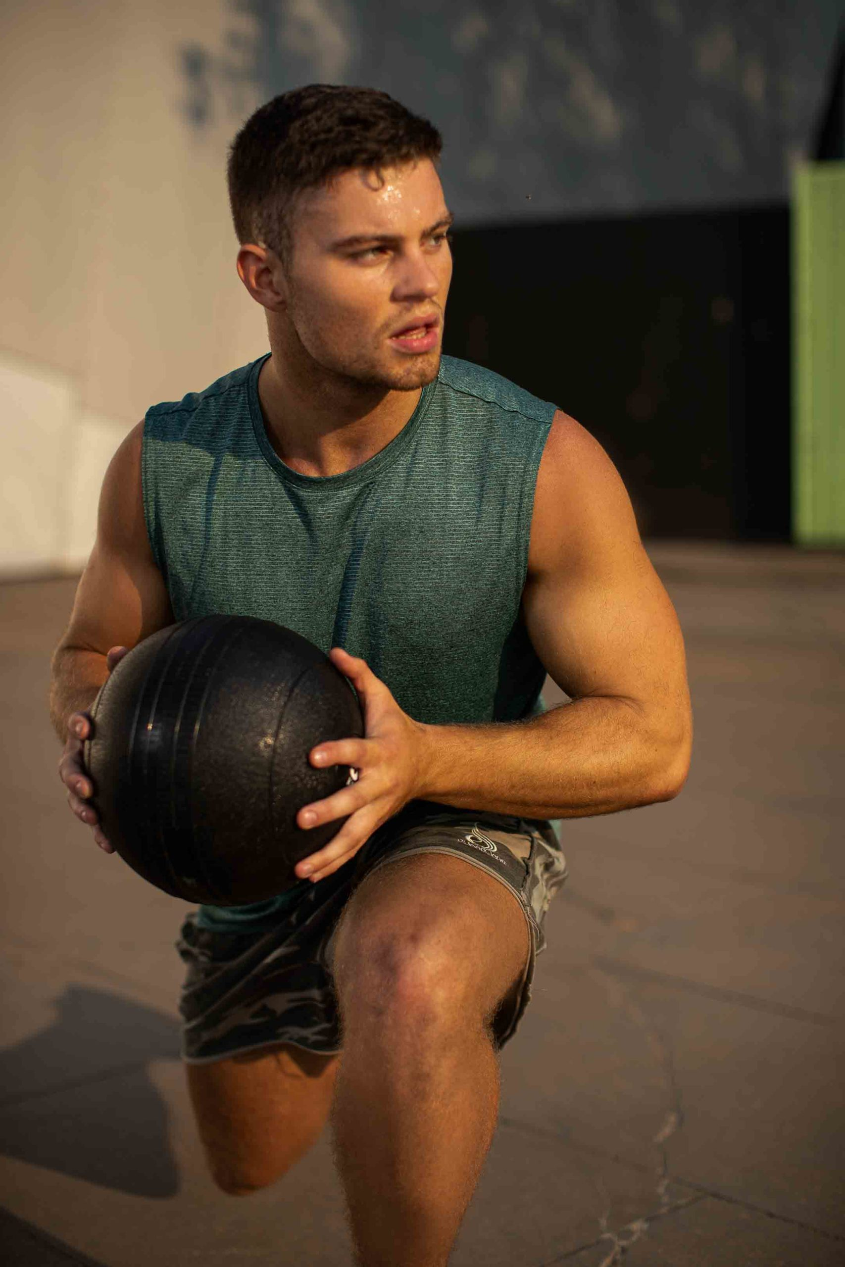 Sean lunging with a medicine ball