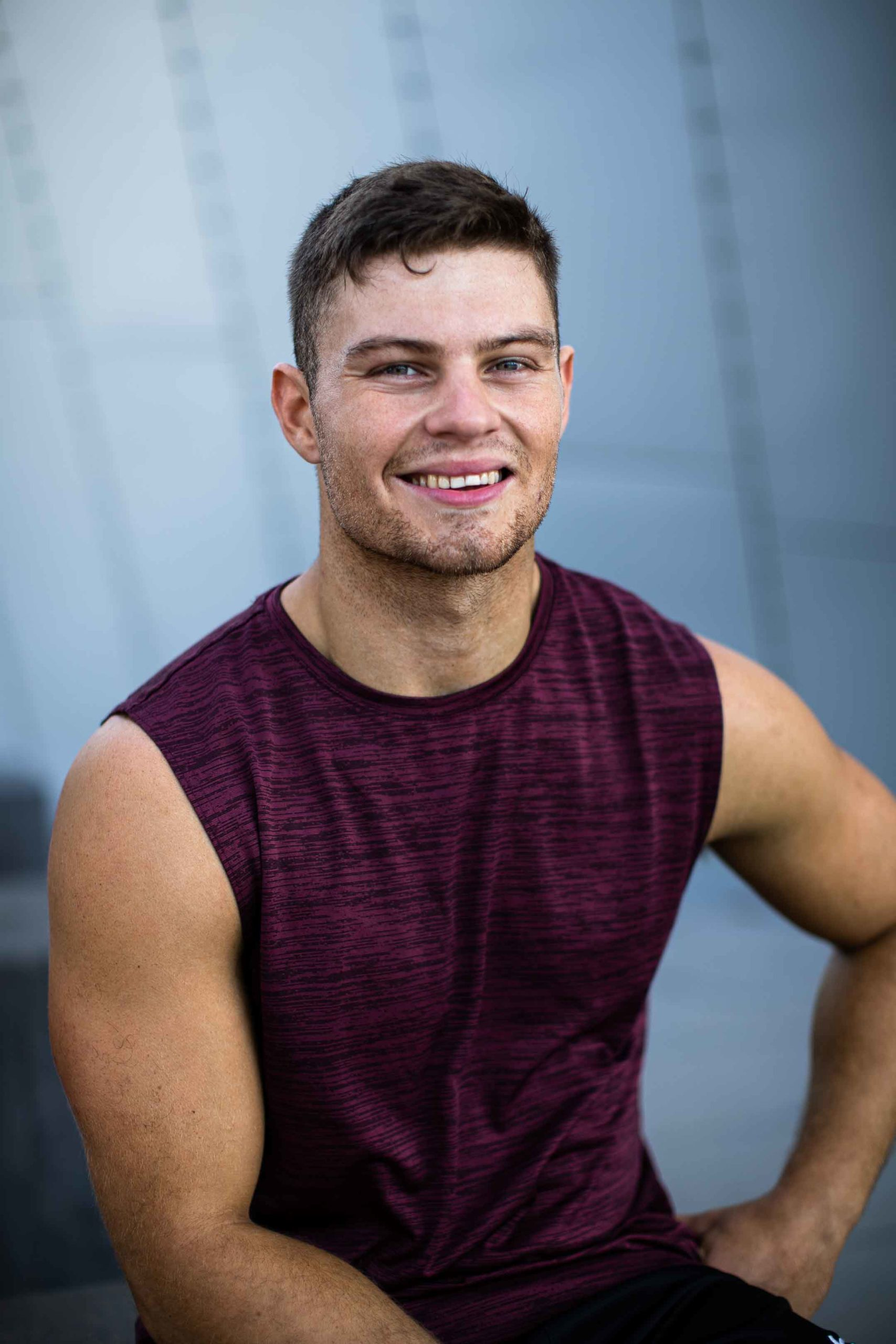 Sean seated smiling during his fitness shoot