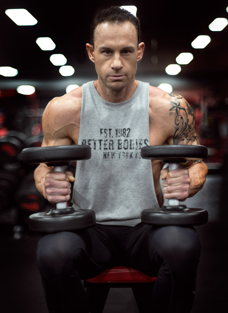Shannon seated holding dumbbells