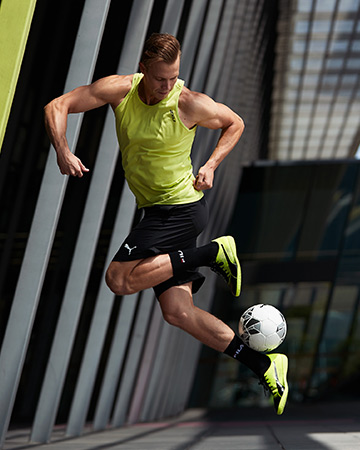 Sam performing soccer skills alongside the Melbourne exhibition Centre