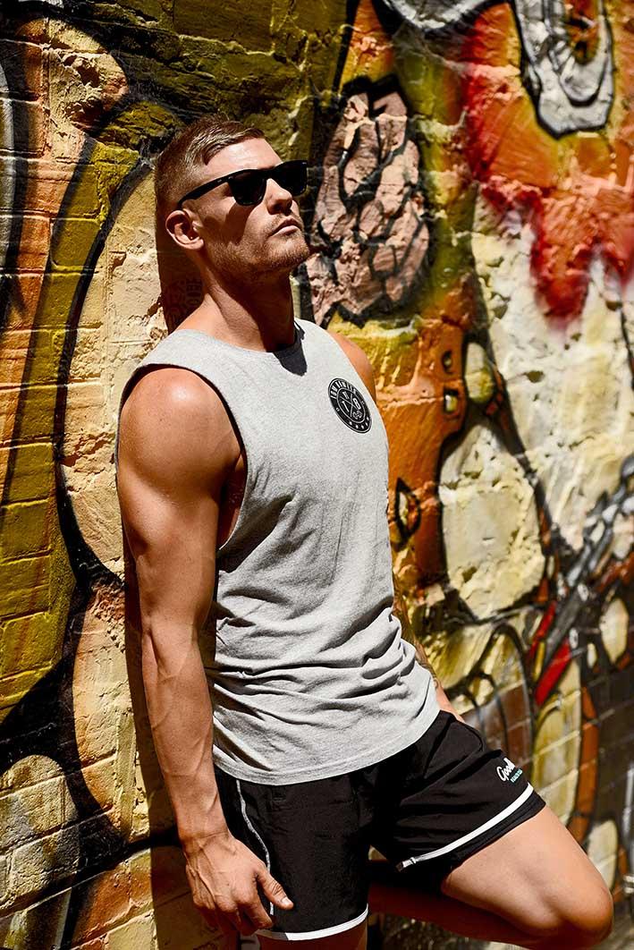 Thomas Adelaide kickboxer relaxing against wall