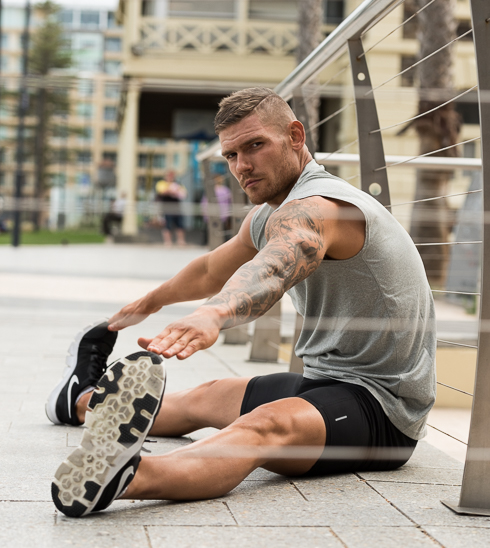 Thomas Adelaides kickboxing athlete stretching